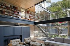 Bacopari House by UNA Arquitetos.  Simple steel framing, the wood planes of the floor and ceiling and the layered transparency of the glass walls together make a very dynamic space. #LivingRoom