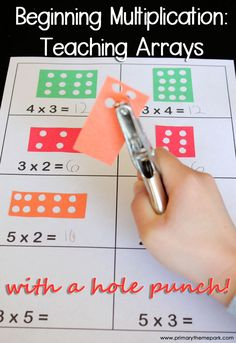 Multiplication Arrays with a Hole Punch.perfect for students just learning multiplication, or for remediation.Teaching Multiplication Arrays with a Hole Punch.perfect for students just learning multiplication, or for remediation. Maths Guidés, Learning Multiplication, Math Classroom, Teaching Math, Multiplication Strategies, Math Multiplication Games, Math Fractions, Multiplication As Repeated Addition, Classroom Decor