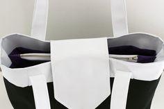 Madison est un élégant sac compartimenté. Pratique, l'intérieur du sac s'organise en 3 parties grâce à une poche séparatrice zippée.