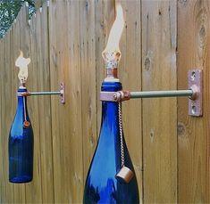 Wine Bottle Tiki Torch - 20 Decorative Handmade Outdoor Lighting Designs - love these!
