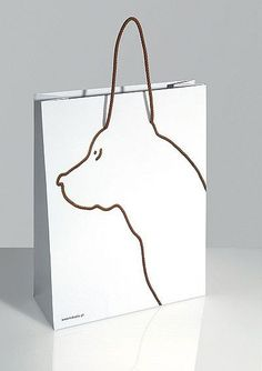 Gift bag. Instead of a dog, it could be a coat hanger with baby clothes hanging on it
