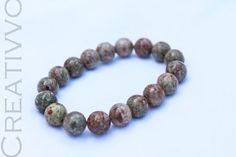 10mm Unakite bracelet  Unakite is a stone with gentle by Creativvo