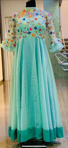 Saree dress - Beautiful sea green color floor length dress with floret lata design hand embroidery thread work on yoke Ready to shipPrice 5500 INRTo order whatsapp 7013728388 23 January 2019 Half Saree Designs, Salwar Designs, Kurti Designs Party Wear, Blouse Designs, Churidhar Designs, Long Gown Dress, Long Frock, Frocks And Gowns, Trendy Dresses