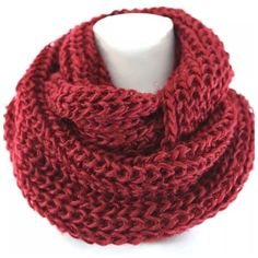 "B118 Chunky Burgundy Metallic Infinity Scarf ‼️PRICE FIRM‼️   Chunky Cable Knit Infinity Scarf  Retail $64  I love chunky scarves!  Red with subtle red metallic threading.  Chunky cable knit.  100% polyester.  Lots of stretch to this super soft yarn scarf.  Dress up any outfit day or night.  Please check my closet for many more scarves and clothing items.   Length 32""   Width 12"" Boutique Accessories Scarves & Wraps"