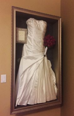 Framed wedding dress with invitation and bouquet, recessed into the wall.  Framed by Floral Keepsakes  www.facebook.com/FloralKeepsakesBoutique