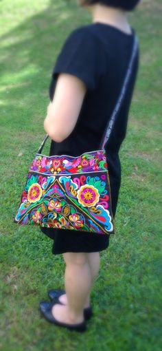 Check out this item in my Etsy shop https://www.etsy.com/listing/237912530/black-hmong-embroidery-floral-crossbody
