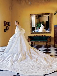 """A peek at the amazing gowns, brides & photography from the book""""Vogue Weddings: Brides, Dresses, Designers""""…viaVogue Lauren Santo Domingo (above), gown & coat by Olivier Theyskens for Nina Ricci, photo by Arthur Elgort 2008 Carolyn Bessette Kennedy, dress by Narciso Rodriguez, photo by Denis Reggie 1996 Charlotte Babcock Brown, gown by Jeanne Lanvin, photo by …"""