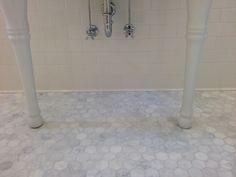 girls bath: carrara hexagon floor tiles paired with white subway wall tiles
