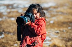 Next Generation - Photography makes everyone happy!  We found this little girl living with nomads in Tibet.