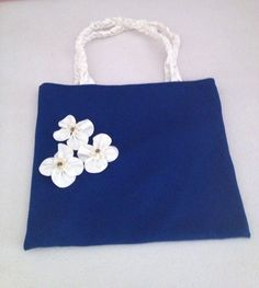 Blue canvas bag with flowers