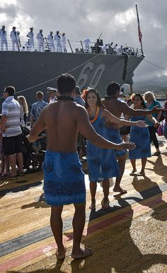 Traditional Hawaiian Hula dancers greet Sailors aboard guided-missile destroyer USS Paul Hamilton (DDG 60) upon the ship's arrival to homeport of Joint Base Pearl Harbor-Hickam following a nine-month deployment. (U.S. Navy photo by Mass Communication Specialist 3rd Class Diana Quinlan/Released)