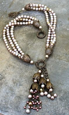 ❥ Designed by Denise Yezbak Moore/ Love this triple strand pearl? silver bead? necklace with the bronze contrasting pieces.