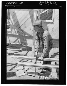 Russell Lee - Vernon Hardcastle, tenant purchase client, working on new home. Wheeler County, Texas (1939)