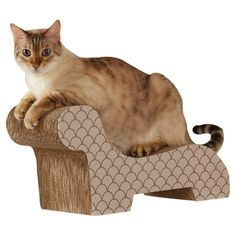 Give your feline friend a place to play with this chic cat scratcher, showcasing a chaise-inspired silhouette and scales motif.   P...