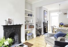 Same layout as ours--feels very open and light. Soft gray paint. Chair separates the two rooms.  from housebeautiful.co.uk