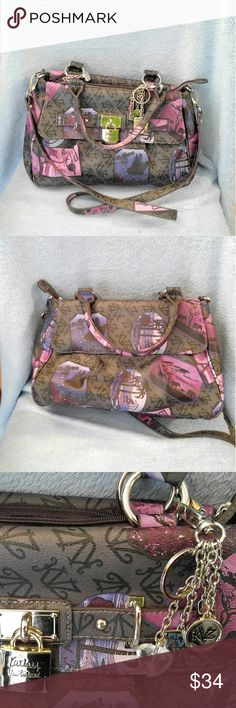 Cute Kathy Van Zeeland Shoulder Bag Kathy Van Zeeland Shoulder Bag- This Purse is in Excellent condition!! It measures 14 X 11 with a 9.5 inch drop. Shoulder Strap measures 20 inches! The Coles in this bag are , purple, pink, grays,and black. There is an area near the top , it appears to be chipping it is not, it's part of the pattern, same for the bottom!! Kathy Van Zeeland Bags