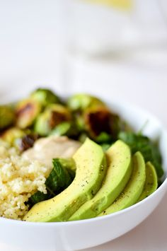 Brussels Sprouts & Quinoa Salad - Packed with dark leafy greens, crispy roasted brussels sprouts, fluffy couscous, creamy avocado and a super simple vinaigrette -- this Roasted Brussels Sprout & Couscous Salad is nutrient-dense, filling and delicious. Healthy Holiday Recipes, Veggie Recipes, Cooking Recipes, Vegetarian Cooking, Healthy Dinners, Vegetarian Recipes, Tahini Salad Dressing, Vinaigrette, Clean Eating