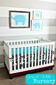 Nursery Ideas Gray and White Elephant Nursery... Love the elephants in frames, not a fan of the striped wall though.