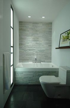 27 Absolutely Gorgeous Bathroom Design Ideas With Brick Walls Beautiful Small Bathroom Tile Ideas to Enhance Interior Quality: Fantastic Bathroom Design With White Tub Grey Tile Wall White Toilet White … Small Bathroom Tiles, Cozy Bathroom, Modern Bathroom Design, Contemporary Bathrooms, Bathroom Interior, White Bathrooms, Bathroom Fixtures, Master Bathroom, Bathroom Grey