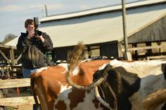 Recent shot of Jonathan while shooting an assignment on a dairy farm at a photography workshop in Kentucky.