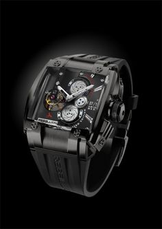 REB-5 with black titanium case. SOLD OUT! The REB-5 features a mechanical tour billion movement and twin mainspring barrels to provide seven days of power.  For more information, please visit: http://www.rebellion-timepieces.com/collection-reb-5-tourbillon-manufacture.php#1