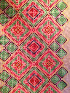A cross stitch Hmong paj ntaub I was working on. A sev.