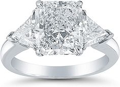 by Martin Flyer, Inc. Radiant cut center diamond with trillions