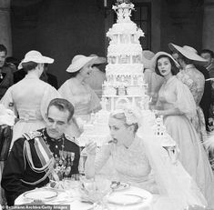 Grace on her wedding day, grabbing a bite with Prince Rainier; Carolyn (right) looks on in the background Grace Kelly Wedding, Princess Grace Kelly, Princess Stephanie, Princess Kate, Tom Selleck Movies, Royal Crown Jewels, State Of Grace, Prince Rainier, Rainy Wedding