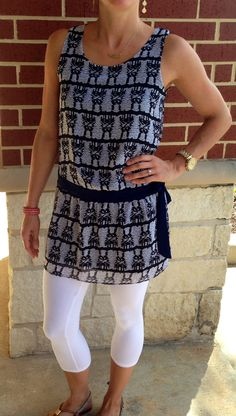 Navy and white tunic that looks fantastic with cropped white capris or leggings! Plenty long enough to cover the behind and it's fully lined so you don't need to worry about it being see-through! Can totally see this worn with jeggings and boots this fall, too! Sz: S-L $62