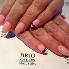 Almond shaped valentine nails.