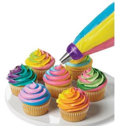 This rainbow swirl buttercream frosting brings a huge pop of color to cupcakes and cakes for birthday parties or any cake recipe. Such a pretty dessert and the rainbow frosting is so easy to do. An easy how to pipe a rainbow swirl tutorial. Cupcake Cones, Cupcake Icing, Buttercream Frosting, Piping Icing, Decorating Tips, Cake Decorating, Decorating Supplies, Cake Pops, Icing Tips