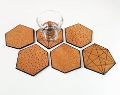 Cork coasters, Coasters cork, Triangle coasters, Geometric coasters, Scandinavian design, Black ink drawing, Polka dot, Set of 6 coasters  These coasters are handmade by me in my home in Eindhoven, the Netherlands. The coasters are made of cork and I drew the print on them by hand with permanent ink.  This set of 6 coasters is not only very practical but will also look lovely in you home, just lying on the table.  You can use the coasters individually for your drinks or combine them to use…
