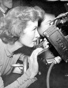""""""" Close-up shot of Greer Garson looking through RCA camera lens on the set of The Miniver Story (1950) """""""