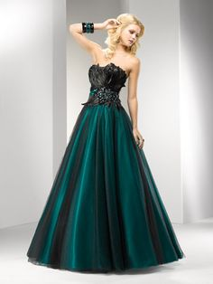 Dark Teal Gown with Black Feather Bodice. My favorite, it is a gorgeous color of dark green and the design on the chest is stunning!