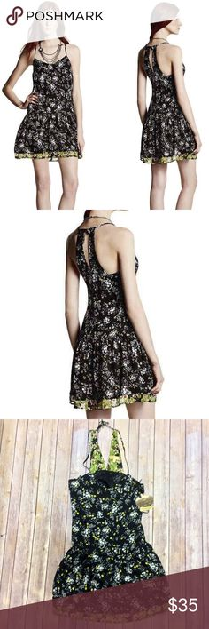 """Princess Vera Wang Floral Flounce Hem Dress XS Brand: Princess Vera Wang from Kohls Silhouette: Racerback Sleeveless Shift Dress Color: Black with White & Yellow floral design Lined: Yes Hidden Zipper: No New with Tags: Yes Orig Price: $58.00 Materials: 100% Polyester Features: Keyhole back accent, scoop neck, drop waist. Size: US Juniors Small  Measurements in Inches from website: Bust: 32.5"""" - 33.5"""" approx Waist: 24.5"""" - 25.5"""" approx Hips: 34.5"""" - 35.5"""" approx Princess Vera Wang Dresses…"""