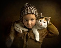This is a great way to showcase your cat and your kid in one photo. Do you know how many hearts this will melt :D