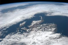 Scotland and the Spring sunshine peeking through at each other over the clouds