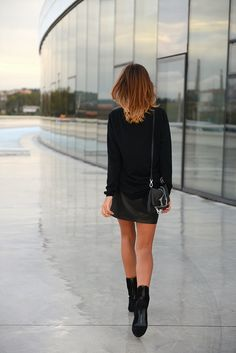 Leather skirt with black blouse. Absolutely love it! Great for work, a casual day, or getting dressed up.