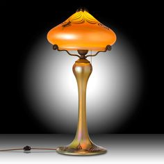 This Luster Art Glass table lamp with a Gold Peacock design is hand blown to order by renowned glass artisan Carl Radke. This Peacock design table lamp is perfect for that desk, side table or night stand and is signed and dated by Radke to assure authenticity and to retain its future collector value.#myOCLlight #oldcalifornia #oldcalifornialighting #craftsmanlighting #madeinamerica #solidbrass #artsandcrafts #lusterglass #tablelamp