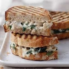 Wilted spinach, shredded chicken and cheese in a creamy sauce makes delicious panini filling on crusty bread spread with additional cream sauce.