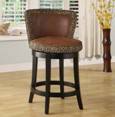 "Lisbon 26"" Swivel Barstool/ Leopard Print Fabric Cover Mbs-11 - Armen Living LCMBS11SWMFAP26 by Armen Living. $255.60. Leopard print fabric material on a 360 degree swivel 26"" high seat w/ espresso wood frame. Reflecting the lifestyle and trends of today with an eye towards tomorrow, the Armen Lisbon Counter Stool blends distinctive styling with a contemporary flair that will truly enhance your home bar or kitchen's look.Features:360 degree swivel seatLeopard print fab..."