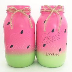 Painted watermelon mason jars. Perfect party decor for a watermelon birthday party.