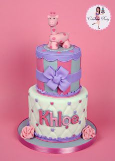 pink giraffe baby shower cake...more pink and brown with a monkey and zebra on top