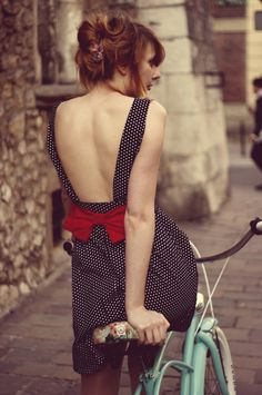 Adorable red bow, black and white polka dot dress, and mint green vintage bicycle