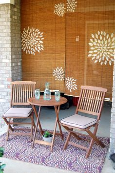 Taking the current bamboo blinds from the patio and try to do something like this, then hand it over the brick wall.