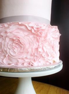 Close up on this fantabulous 2 tier wedding cake with blush and silver wedding colors. Ruffle wedding cake