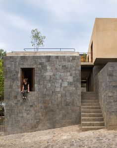 Mexico City-based architect Rozana Montiel has completed a four-bedroom home in Tepoztlán, using local materials as a way to integrate the home into its natural setting.