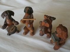 """anri dog band carved wood 