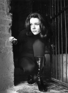 Diana Rigg ~ Best known as Emma Peel on the popular TV series The Avengers, English actress Diana Rigg is an official dame of the British empire, but let's talk about what she did for leather boots and flippy hair.