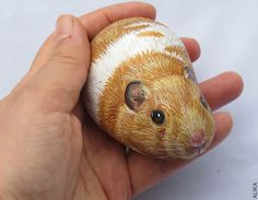 Painted rock stone art hamster reserved for Anel